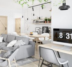 Sala de estar minimalista escandinava com home office integrado