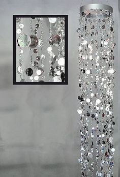 DecoStar™ Long Champagne Bubbles Chandelier - Silver DecoStar™ Shimmery silver beads make this chandelier super chic. Each of the five foot long strands are bedecked with our popular champagne bubble beads. The diameter is 7 inches. Bubble Chandelier, Hanging Chandelier, Beaded Chandelier, Sequin Curtains, Black Curtains, Event Decor Direct, How To Make Beads, Wind Chimes, Popsicle Stick Crafts
