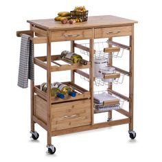 Zeller This kichen trolley made of bamboo stands out with its easy to clean surface. Three drawers, 3 baskets, a hook and six bottle holders make this trolley a storage wonder. Kitchen Units, Buy Kitchen, Wooden Kitchen, Kitchen Cart, Kitchen Storage, Folding Furniture, Kitchen Furniture, Kitchen Island Trolley, Kitchen Islands