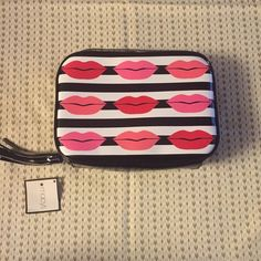 Make Up Tool Travel Case This cute zip around bag is so perfect to keep your make up tool and necessities organized in one place. Patent leather lips design with a cute tassel used to open and close the zipper. Macy's Bags Cosmetic Bags & Cases