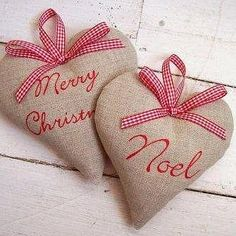 A lovely Christmas welcome to hang from your door.    These hearts are handmade using natural linen and backed with red cotton gingham. Embroidered with a choice of two festive greetings; Merry Christmas or Noel and finished with a red spot, check or stripe bow.    There is also a choice of three fillings; dried lavender, cinnamon and clove padding or plain padding.