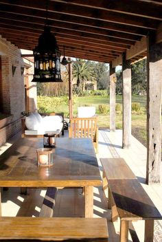 Relaxing and beautiful wooden table under an awning. By Aulet & Yaregui Arquitectos Garage Pergola, Deck With Pergola, Pergola Patio, Backyard, Outdoor Tables, Outdoor Spaces, Outdoor Living, Outdoor Decor, Porch And Terrace