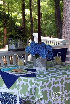 Wanted: A better name for this invention I created! What is it? I consider it a multi-purpose centerpiece for your umbrella-shaded patio table. But, it can also be a serving station for utensils and napkins. Add some water and it becomes a vase for the table. When the flowers wilt, plant some shade …