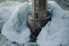 © Jean Guichard, Dec. 21, 1989, Lighthouse of 'La Jument', Breton' --- In 1989 a tempest raged for days and the lighthouse keepers held on tight, hoping the structure would resist. In spite of this, the keeper, Théodore Malgorne, dared open the door, intrigued by the noise of Jean Guichard's helicopter. He closed the door in time and was unharmed. ---- I had this picture in my room for years when I was a kid. As I just recently found it I wanted to share this story with you.