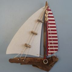 Read how we learned to make driftwood decorations at Gower Craft. we love this Driftwood Boat by Andrea Brewster which is made using bits of found fabric, driftwood and string. Driftwood Projects, Driftwood Art, Red Crafts, Sailboat Art, Seaside Decor, Creation Deco, Media Wall, Sticks And Stones, Beach Crafts