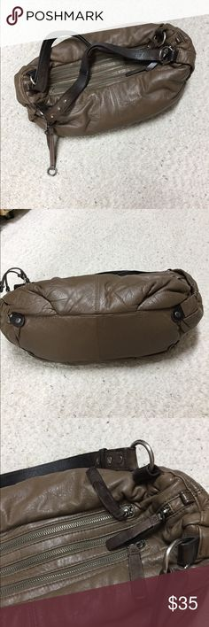 BCBGMAXAZRIA Leather Handbag BCBGMAXAZRIA cocoa brown leather handbag with three outer zippers. Three inside pockets. Dark chocolate leather handles. Silver hardware. Good condition. Leather extremely soft. No wear on outer bottom. BCBGMaxAzria Bags Hobos