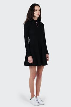 Lazy OafHeart Button Polo Dress - blackSizing: Regular - shop to sizeMaterial: 100% cotton- Polo shirt style dress- Polo neck collar with heart buttons- Long sleeves- Skirt bottom sitting above knee- Designed in the UK