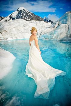 """Nothing says """"stunning wedding photos"""" like making the bride wade into a freezing-cold Windex-blue pool of water on top of a glacier in Alaska. http://petapixel.com/2014/08/27/gorgeous-wreck-dress-wedding-photos-captured-stunning-glacier-alaska/"""