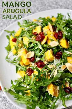 A delicious and easy Mango Arugula Salad. Enjoy the fresh mango incorporated wit… A delicious and easy Mango Arugula Salad. Enjoy the fresh mango incorporated with raisins and salad dressing. Arugula Salad Recipes, Best Salad Recipes, Mango Recipes, Fruit Salad Recipes, Salad Dressing Recipes, Chicken Salad Recipes, Healthy Recipes, Chicken Pasta, Simple Salad Recipes