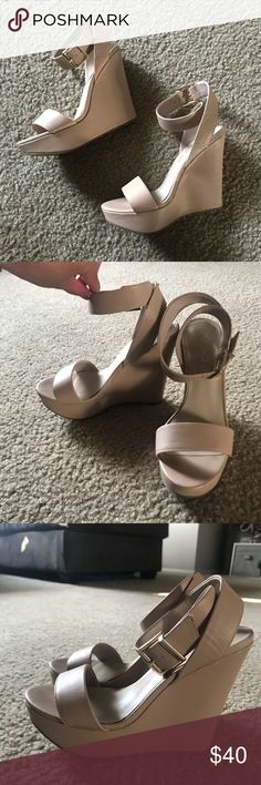 """Nude Aldo Wedge Heels These chic and sexy cream/beige wedges are gorgeous 😍 features a wrap around ankle strap with gold buckle and a cross strap along the toes. The tan color makes your legs look super long. Comfy, but just a tad too high for my taste. These need a great home and are in great condition. Heel measures 5"""". Size 6, true to size. Aldo Shoes Wedges"""