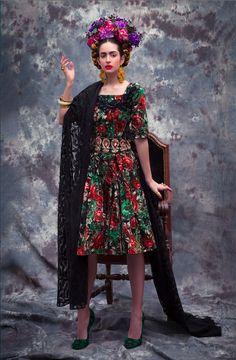 Frida Kahlo by CINQ Flowers and concept :Guy Debast Photographer: Isabella Abel  Model: Cornelia - Look Models Internnational Stylist : Judith Jules Beck  Hair and makeup: Roberto Caro  Fashion: Dress: Lena Hoschek, Cape: Love Irene, Shoes: Prada Jewelry: Earrings: Kenneth Jay Lane, Rings: Petra Hauser