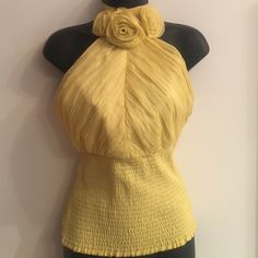 bebe yellow halter chiffon ruche top Gorgeous halter! Well-made. Can be worn alone or under a blazer. Delicate fabric, with underlining. Can be tied in the back or on the side of your neck. High collar. Beautiful flowers. bebe Tops Blouses