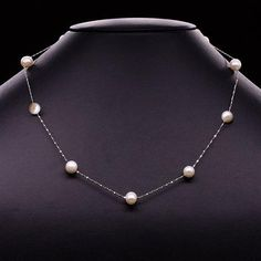 Pearls in Silver Necklace — $195.00. While a classic strand of pearls — laden with the iridescent silky orbs — is always beautiful, there are times when the pearl calls out for a less crowded arrangement. Our Pearls in Silver Necklace is the perfect example of what can happen when pearls let loose. Nine freshwater cultured pearls shimmer and revel in their freedom on a rope chain of shining sterling silver. This necklace is perfect for any occasion.