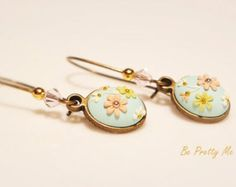 Turquoise on pastel blooms. Elegantly hand-crafted dangle earrings