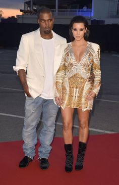Pin for Later: How Kim Kardashian Went From LA Party Girl to Hot Mom and Mogul  They were front and center at Kanye's Cruel Summer film premiere during the Cannes Film Festival in May 2012.