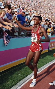 Inspirational Moments: Olympic celebrations - LOS ANGELES, CA - AUG 6 1984: Carl Lewis of the USA celebrates his gold medal win in the Long Jump final during the 1984 Olympic Games. Lewis won the gold medal with a jump of 8. 54 metres at the Colliseum Stadium on August 6, 1984 in Los Angeles. (Photo by Tony Duffy / Getty Images )