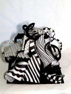 op art paper sculpture...good end of the year option to do with recycled poster board.