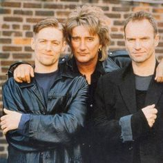 Rod Stewart (center) with Bryan Adams (left) and Sting