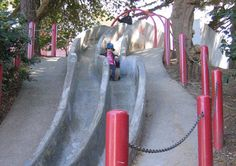 "The San Francisco Recreation and Parks Department warns that the steep, long, curvy concrete double slides at a tiny park in the Castro district ""are not for tiny tots, nor the faint of heart."""
