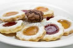 Delicious christmas cookies with raspberry jam on white