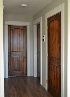 Love the doors - Big white trim, beautiful stained wood doors and wood floors. Interior Trim, Interior Barn Doors, Home Interior, Interior Design, Modern Interior, Replacing Interior Doors, Farmhouse Interior Doors, Interior Door Styles, French Interior