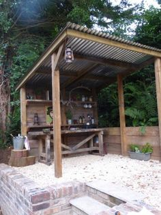 small rustic outdoor kitchen ideas under a porch with landscaping - Google Search