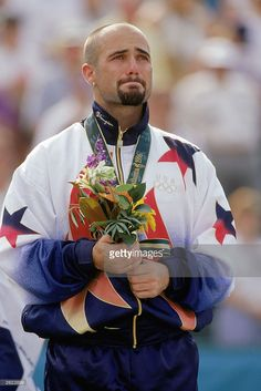Andre Agassi is full with emotion as he stands as the men's tennis singles gold medal winner during the XXVI Olympic Games at the Stone…