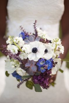 Love the colors and texture of this bouquet - white anemone, white stock, lilac, seeded eucalyptus, pop of blue delphinium - remove succulants - add white hydrangea, lavender, calla's, orchids, ranunculus