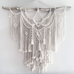 Large Macrame Wall hanging A fusion knots and of course lots of fringing! The star of this piece is a beautiful long branch. Your piece is made by hand using natural unbleached cotton and revived branches from local woods in Upstate NY and the Adirondacks. ✨✨✨ SIZING She measures roughly 44in x 45in (including the branch) so she is sure to stand out wherever you choose to hang her. Sizing is approximate: Branch Width - 44 Macrame Length - 38 Rope hanger- 10 ✨✨✨ MADE TO ORDER I will rep...