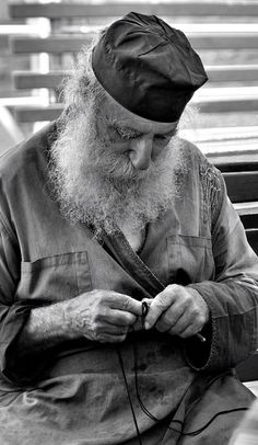 orthodox monk making a prayer rope