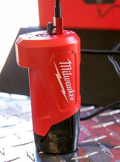 Milwaukee Battery and Phone Charger Plugged in for Charging New Milwaukee Tools, Milwaukee M12, Garage Bench, Tool Board, Plumbing Tools, Best Woodworking Tools, Metal Shop, Ponds Backyard, Phone Charger