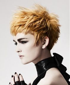 A short blonde straight coloured spikey choppy hairstyle by Annette Bradford