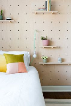Make your headboard functional AND stylish with a oversized pegboard.