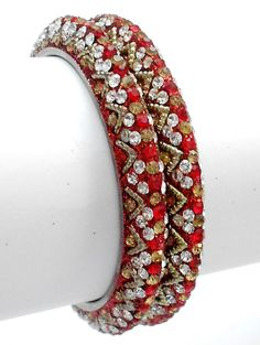 Exclusive and very Latest pair of Indian Designer Lakh Bangles, crafted and designed beautifully with high quality glass stones.