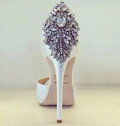 Diamonds on the heels of her shoes....