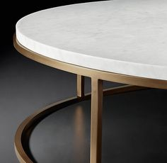 RH Modern's Nicholas Marble Round Coffee Table:Pairing marble's luminous warmth with metal's cool luster, this table designed by the Van Thiels is a study in complementary contrasts. Inspired by a 1960s French original, it is a striking surface for display.