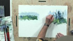 Tom Jones, professional watercolor artist, shows you how to create a more interesting tree line by avoiding straight lines and order. To see more about this ...