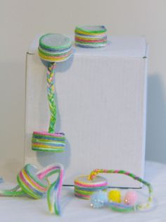 homemade cat toys with bottle caps, yarn, catnip
