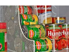 Use a magazine holder to keep cans organized in the pantry.