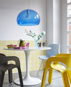 kartell chairs, tulip table