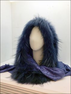 If you need a more elegant lookthan Eat Muffs, swing by Fendi® for this furry wrap. Get close to see a Fendi logo watermarked interior, and soft fabric covered headform to reinforce a gauzy romant...