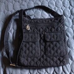 Vera Bradley cross body bag Vera Bradley cross body black quilted bag. It's 12x12 with silver hardware. Vera Bradley Bags Crossbody Bags