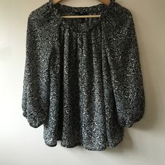 Boho Blouse  Beautiful pattern, chiffon like material, button down. Looks black but I believe it's navy since the buttons are navy.  H&M Tops