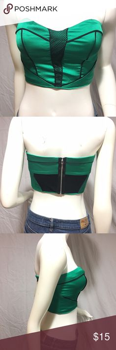 """Bebe crop top Green strapless crop top with black detailing. Has fish netting down the middle of the front, and on the back. Has a zipper that goes all the was down the back. Length: 9"""", width: 13 1/2"""" across. Has a small pull on the back as seen in fifth picture. Not very noticeable. Besides that in great condition. Feel free to make me a reasonable offer 💕 bebe Tops Crop Tops"""