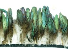 Maybe too green for Sansa Mockingbird feathers. Perhaps they could be used as an accent on the shoulders.