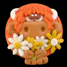 Flowery Highland Cow Magnet £6.95  Handmade on the Isle of Skye by Skye Raven Crafts using Sculpey and Fimo polymer clay.