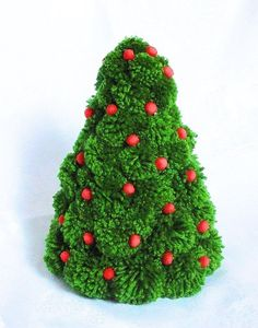 Green fluffy pompom Christmas tree. The decoration of the tree is small red felt baubles. On the second photo, you see a matching pompom wreath - great set of Christmas decoration. Height: 22 cm Width at the bottom: 16 cm  If you wish to buy more products from my shop - please contact - we will agree the best solution for you.  You might also like matching Christmas wreath: https://www.etsy.com/your/shops/PompomWorldCom/tools/listings/view:table,stats:true/255721105  Check my Christmas…