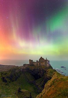 Night Aurora above Dunluce Castle in Northern Ireland