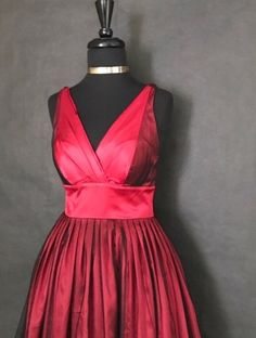 This is a beautiful vintage inspired flow dress. Made by Morgan & Company. The dress is red and black, made of 100% polyester, has a v-neck line, is sleeveless and long in length.    The dress is a size 5/6 with be following measurements:        MEASUREMENTS    - Length: 41 inches    - Bust: 30 inches    - Waist: 26 inches    - Hips: Free    This item ships immediately to US addresses. 📦 | Shop this product here: http://spreesy.com/UyleesBoutique/888 | Shop all of our products at…
