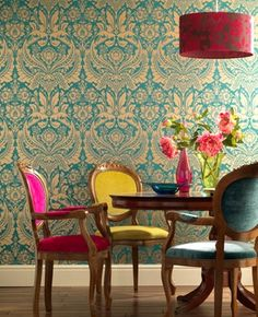 I love how the chairs match but have coordinating fabrics, against the tightly patterned wallpaper they look stunning.